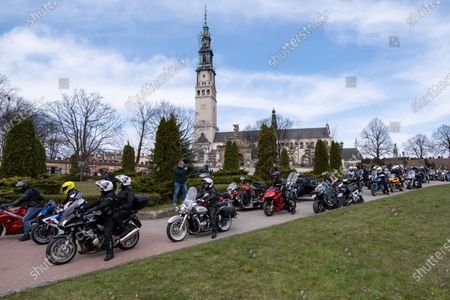 Motorcyclists seen riding in front of Jasna Gora Monastery. Every year in the spring thousands of motorcyclists come to Jasna Gora Monastery in Czestochowa for blessing of motorcycles. It is known as the official opening of motorcycle season in Poland. Jasna Gora with the image of the Black Madonna is the biggest sanctuary in Poland for all Catholics.