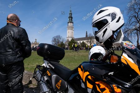 A motorcyclist stands next his bike in front of Jasna Gora Monastery. Every year in the spring thousands of motorcyclists come to Jasna Gora Monastery in Czestochowa for blessing of motorcycles. It is known as the official opening of motorcycle season in Poland. Jasna Gora with the image of the Black Madonna is the biggest sanctuary in Poland for all Catholics.