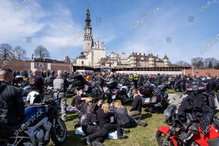 Motorcyclists and their bikes seen in front of Jasna Gora Monastery. Every year in the spring thousands of motorcyclists come to Jasna Gora Monastery in Czestochowa for blessing of motorcycles. It is known as the official opening of motorcycle season in Poland. Jasna Gora with the image of the Black Madonna is the biggest sanctuary in Poland for all Catholics.