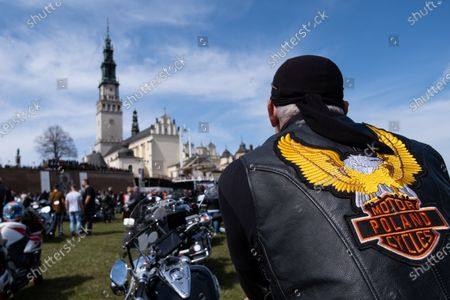 A motorcyclist seen on his bike in front of Jasna Gora Monastery. Every year in the spring thousands of motorcyclists come to Jasna Gora Monastery in Czestochowa for blessing of motorcycles. It is known as the official opening of motorcycle season in Poland. Jasna Gora with the image of the Black Madonna is the biggest sanctuary in Poland for all Catholics.