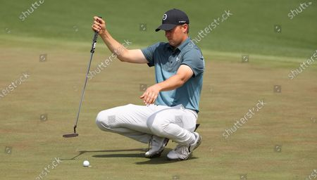 Jordan Spieth of the US lines up his putt on the second hole during the final round of the 2021 Masters Tournament at the Augusta National Golf Club in Augusta, Georgia, USA, 11 April 2021. The 2021 Masters Tournament is held 08 April through 11 April 2021.