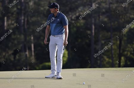 Stock Image of Jordan Spieth of the US reacts to his putt on the eighteenth hole during the final round of the 2021 Masters Tournament at the Augusta National Golf Club in Augusta, Georgia, USA, 11 April 2021. The 2021 Masters Tournament is held 08 April through 11 April 2021.