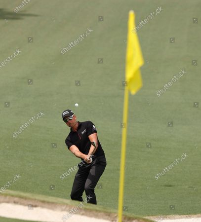 Henrik Stenson of Sweden chips on the second hole during the final round of the 2021 Masters Tournament at the Augusta National Golf Club in Augusta, Georgia, USA, 11 April 2021. The 2021 Masters Tournament is held 08 April through 11 April 2021.
