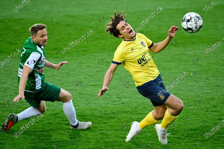 Lommel's Robin Henkens and Union's Mathias Fixelles fight for the ball during a soccer match between Lommel SK and Royal Union Saint-Gilloise, Sunday 11 April 2021 in Lommel, on day 26 of the 'Proximus League' 1B second division of the Belgian soccer championship.