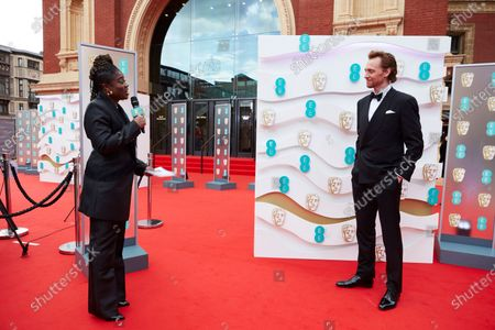 London, Sunday 11th April 2021: Official EE host Clara Amfo and Tom Hiddleston at the 2021 EE British Academy Film Awards. Interviews will be available exclusively at twitter.com/ee