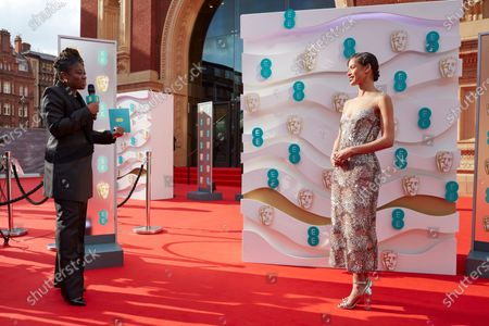 London, Sunday 11th April 2021: Official EE host Clara Amfo and Gugu Mbatha-Raw at the 2021 EE British Academy Film Awards. Interviews will be available exclusively at twitter.com/ee
