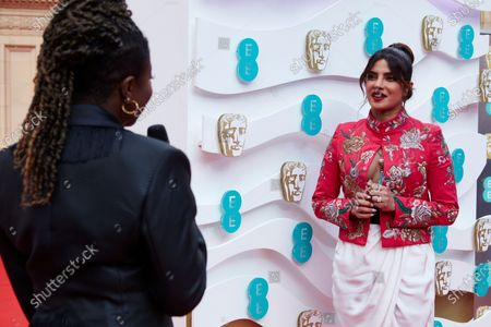 London, Sunday 11th April 2021: Official EE host Clara Amfo and Priyanka Chopra Jonas at the 2021 EE British Academy Film Awards. Interviews will be available exclusively at twitter.com/ee