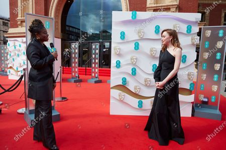 London, Sunday 11th April 2021: Official EE host Clara Amfo and Phoebe Dynevor at the 2021 EE British Academy Film Awards. Interviews will be available exclusively at twitter.com/ee
