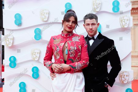 London, Sunday 11th April 2021: Priyanka Chopra Jonas and Nick Jonas at the 2021 EE British Academy Film Awards. Interviews will be available exclusively at twitter.com/ee