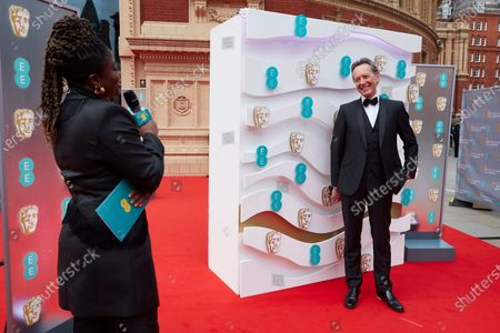 London, Sunday 11th April 2021: Official EE host Clara Amfo and Richard E Grant at the 2021 EE British Academy Film Awards. Interviews will be available exclusively at twitter.com/ee