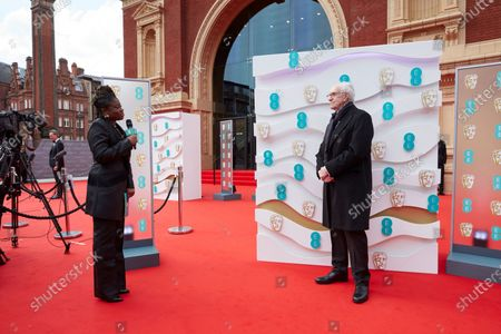 London, Sunday 11th April 2021: Official EE host Clara Amfo and Jonathan Pryce at the 2021 EE British Academy Film Awards. Interviews will be available exclusively at twitter.com/ee