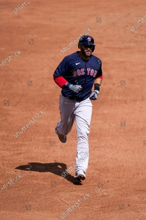 Boston Red Sox's J.D. Martinez runs the bases after hitting a solo home run against Baltimore Orioles pitcher Mac Sceroler during the sixth inning of a baseball game, in Baltimore