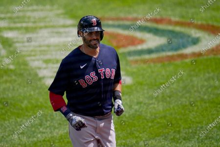 Boston Red Sox's J.D. Martinez trots to the dugout after hitting a solo home run off Baltimore Orioles starting pitcher Jorge Lopez during the third inning of a baseball game, in Baltimore