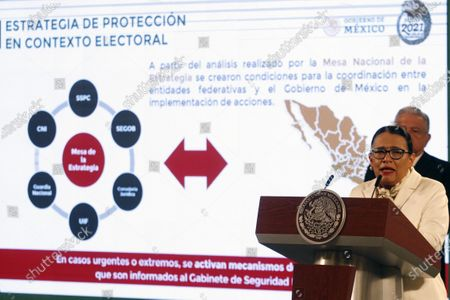 Stock Image of Mexico's President Lopez Obrador seen behind  of Secretary of Security and Citizen Protection of Mexico, Rosa Icela Rodriguez  while gesticulates when talking   during a Daily Morning press conference at National Palace. On April 9, 2021 in Mexico City, Mexico.