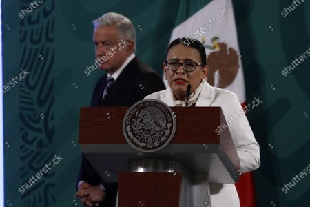 Mexico's President Lopez Obrador seen behind  of Secretary of Security and Citizen Protection of Mexico, Rosa Icela Rodriguez  while gesticulates when talking   during a Daily Morning press conference at National Palace. On April 9, 2021 in Mexico City, Mexico.