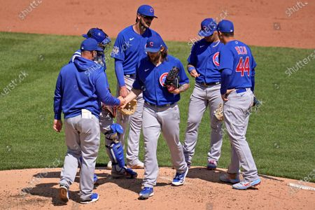 Chicago Cubs starting pitcher Trevor Williams hands the ball to manager David Ross as he leaves the baseball game against the Pittsburgh Pirates in the fifth inning in Pittsburgh