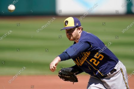 Stock Picture of Milwaukee Brewers starting pitcher Brett Anderson throws during the first inning of a baseball game against the St. Louis Cardinals, in St. Louis