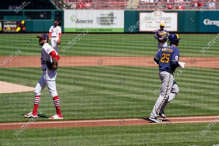 Stock Photo of St. Louis Cardinals starting pitcher Daniel Ponce de Leon, left, walks off the mound after giving up a bases loaded walk to Milwaukee Brewers' Brett Anderson (25) during the first inning of a baseball game, in St. Louis
