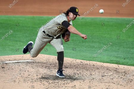 Stock Photo of San Diego Padres relief pitcher Taylor Williams (45) delivers a pitch against the Texas Rangers during a baseball game, in Arlington, Texas