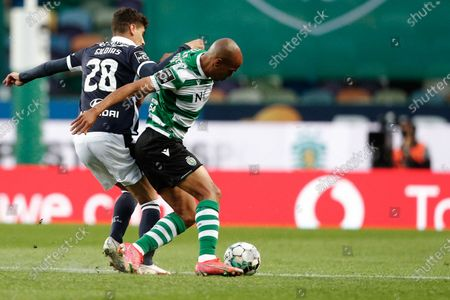 Sporting's player Joao Mario (R) in action against Gil Dias of Famalicao during the Portuguese First League soccer match at Alvalade Stadium in Lisbon, Portugal, 11 April 2021.