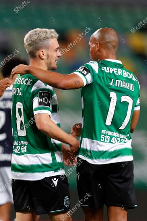 Sporting's Pedro Goncalves (L) celebrates with his teammate Joao Mario after scoring a goal against Famalicao during the Portuguese First League soccer match at Alvalade Stadium in Lisbon, Portugal, 11 April 2021.