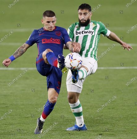 Real Betis' Nabil Fekir (R) in action against Atletico Madrid's Lucas Sebastian Torreira (L) during the Spanish LaLiga soccer match between Real Betis and Atletico Madrid at Benito Villamarin stadium in Sevilla, southern Spain, 11 April 2021.