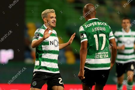 Pedro Goncalves of Sporting CP (L) celebrates with Joao Mario after scoring a goal during the Portuguese League football match between Sporting CP and FC Famalicao at Jose Alvalade stadium in Lisbon, Portugal on April 11, 2021.