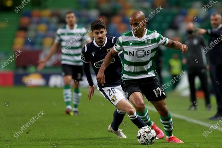 Joao Mario of Sporting CP (R ) vies with Gil Dias of FC Famalicao during the Portuguese League football match between Sporting CP and FC Famalicao at Jose Alvalade stadium in Lisbon, Portugal on April 11, 2021.