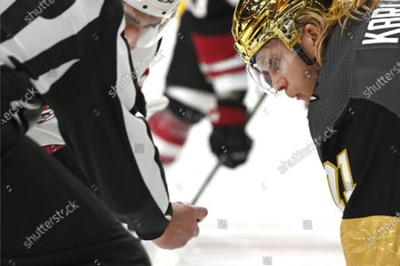Vegas Golden Knights center William Karlsson (71) eyes the puck in a face off against the Arizona Coyotes during the third period of an NHL hockey game, in Las Vegas