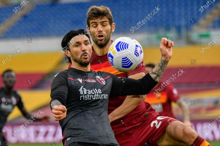 Roberto Soriano of Bologna FC and Federico Fazio of AS Roma seen in action