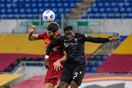 Adama Soumaoro of Bologna FC and Federico Fazio of AS Roma seen in action