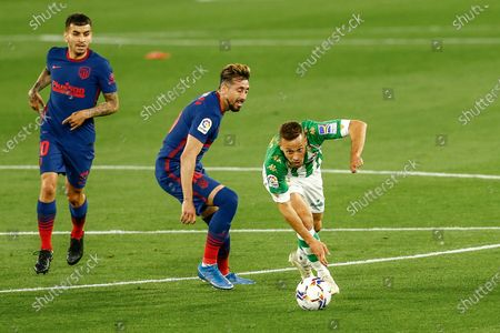 Sergio Canales of Real Betis and Hector Herrera and Angel Correa of Atletico de Madrid