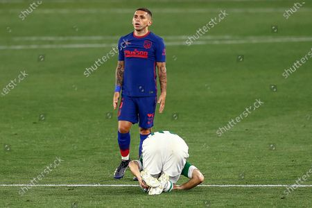 Lucas Torreira of Atletico de Madrid and Guido Rodriguez of Real Betis