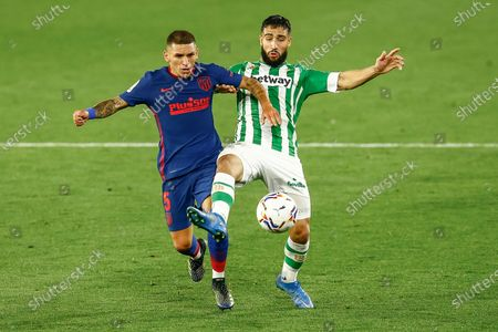 Nabil Fekir of Real Betis and Lucas Torreira of Atletico de Madrid