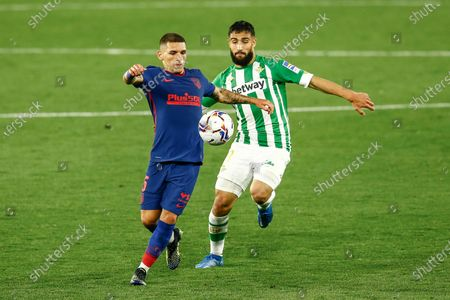 Lucas Torreira of Atletico de Madrid and Nabil Fekir of Real Betis