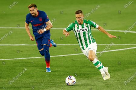 Sergio Canales of Real Betis and Hector Herrera of Atletico de Madrid