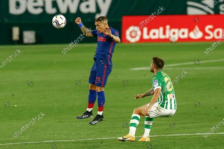 Lucas Torreira of Atletico de Madrid and Aitor Ruibal of Real Betis