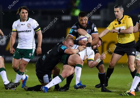 Facundo Gigena of London Irish is double-tackled by Jack Walker and Taulupe Faletau of Bath Rugby