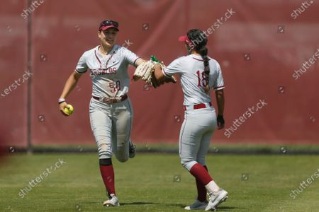 Ashley Trierweiler of Santa Clara celebrates with Allyson Ferreira after making a catch in left field against Loyola Marymount during an NCAA softball game on in Santa Clara, Calif