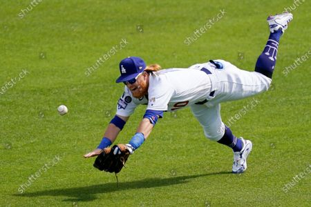 Los Angeles Dodgers third baseman Justin Turner can't reach a ball hit for a single by Washington Nationals' Andrew Stevenson during the eighth inning of a baseball game, in Los Angeles