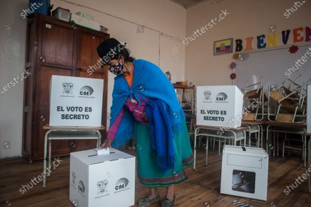 A woman from the indigenous community casts her vote during the elections. In the Cancaghua indigenous parish near Cayambe in the province of Pichincha, people from different communities move to jose antonio Vallejo educational unit to exercise their rights. This Sunday the new ruler of Ecuador is elected.