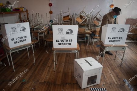 A man from the indigenous community   casts his vote during the elections. In the Cancaghua indigenous parish near Cayambe in the province of Pichincha, people from different communities move to jose antonio Vallejo educational unit to exercise their rights. This Sunday the new ruler of Ecuador is elected.
