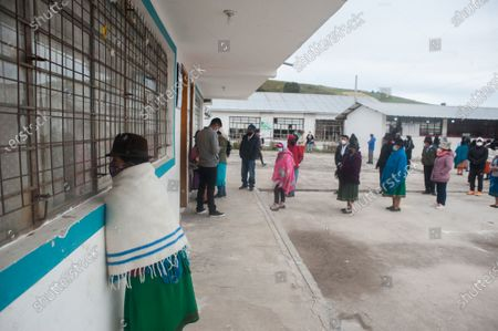 People wait in a queue to cast their votes during the elections. In the Cancaghua indigenous parish near Cayambe in the province of Pichincha, people from different communities move to jose antonio Vallejo educational unit to exercise their rights. This Sunday the new ruler of Ecuador is elected.