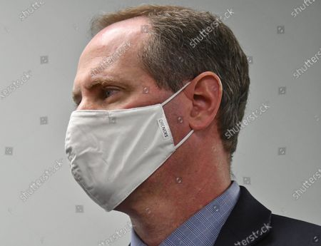 Congressman Tracy Mann (R-KS)  with his mask on listens to reporters questions during a news conference after touring newly installed facilities at Newman Regional Hospital to provide better treatment for local veterans April 9, 2021.