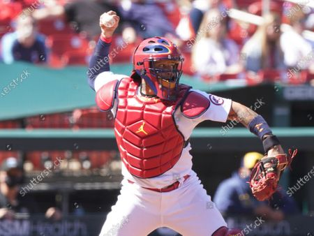 St. Louis Cardinals catcher Yadier Molina throws the bunted baseball by Milwaukee Brewers pitcher Brett Anderson to second base to get the runner and a double play, in the fifth inning at Busch Stadium