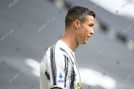 Cristiano Ronaldo of Juventus FC smiles during the Serie A football match between Juventus and Genoa CFC. Sporting stadiums around Italy remain under strict restrictions due to the Coronavirus Pandemic as Government social distancing laws prohibit fans inside venues resulting in games being played behind closed doors. Juventus won 3-1 over Genoa