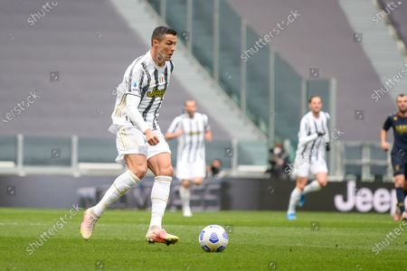Stock Photo of Cristiano Ronaldo of Juventus FC during the Serie A football match between Juventus and Genoa CFC. Sporting stadiums around Italy remain under strict restrictions due to the Coronavirus Pandemic as Government social distancing laws prohibit fans inside venues resulting in games being played behind closed doors. Juventus won 3-1 over Genoa