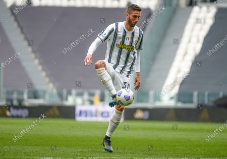 Rodrigo Bentancur of Juventus FC during the Serie A football match between Juventus and Genoa CFC. Sporting stadiums around Italy remain under strict restrictions due to the Coronavirus Pandemic as Government social distancing laws prohibit fans inside venues resulting in games being played behind closed doors. Juventus won 3-1 over Genoa