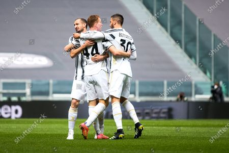 Dejan Kulusevski of Juventus FC celebrates whit Rordrigo Bentancur and Giorgio Chiellini after the goal of 1-0 during the Serie A football match between Juventus and Genoa CFC. Sporting stadiums around Italy remain under strict restrictions due to the Coronavirus Pandemic as Government social distancing laws prohibit fans inside venues resulting in games being played behind closed doors. Juventus won 3-1 over Genoa
