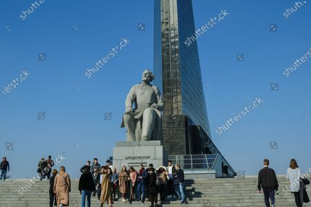 Visitors pose for pictures near the monument to the theoretician of Soviet cosmonautics Konstantin Eduardovich Tsiolkovsky.The Cosmonautics Museum is one of the largest scientific and historical museums in the world. The history of the museum began in the second half of the 20th century, when in 1964 a monument to the Conquerors of Space appeared on the map of Moscow.The titanium rocket at VDNKh has become a symbol of a qualitative technological leap of its time. The launch of the first artificial Earth satellite, the first living beings and the first man in space became the starting point in world cosmonautics.On the 60th anniversary of the first manned flight into space, tourists came to visit the Museum of Cosmonautics to learn more about the first cosmonaut, the Soviet test pilot Yuri Gagarin.